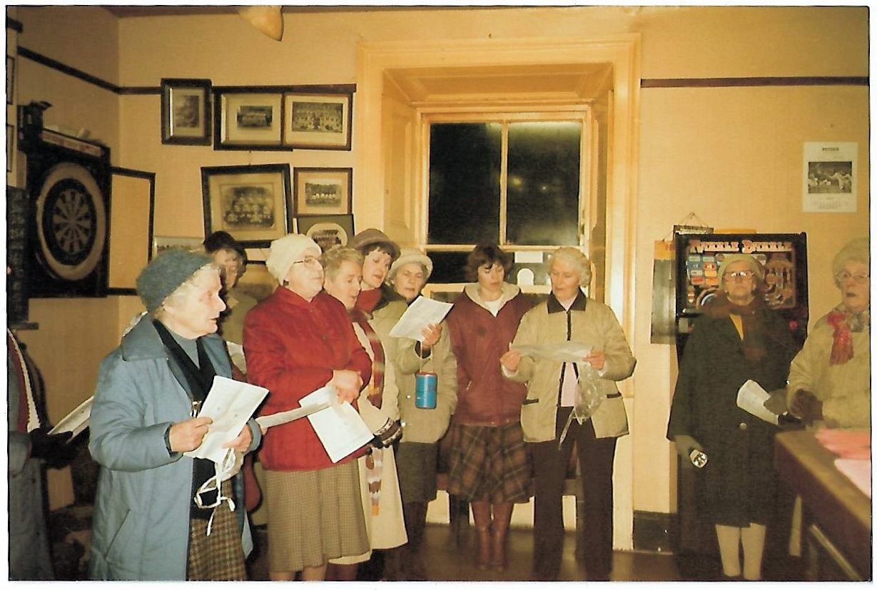 Interior of White Hart with WI carol singers C1980